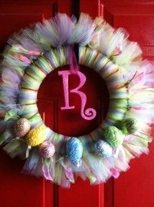 Pretty Spring/Easter Wreath made with tulle, monogram and colorful eggs. #DIY #Door