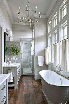 Beautiful bath : rustic wood floors, shiplap, chandelier, grey vanity