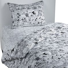 Ethan Allen | Disney Mickey Mouse Comic Strip Duvet Cover, Mickey's Ears (Black), Full/Queen Duvet Cover:   Start every day with a smile! Fresh and contemporary with a distinctly retro vibe, our Comic Strip comforter cover is pure fun. Made in Italy from 100% cotton percale, it's available in twin and full/queen sizes; openings at the top and ties on all four corners make it easy to fluff or change out. Because all Ethan Allen|Disney bedcoverings, blankets, pillows, and shams are desig...