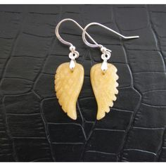 SALE, Angel Wing Earrings,Yellow Jade Earrings,Intricately Hand Carved... ($24) ❤ liked on Polyvore featuring jewelry, earrings, sterling silver gemstone jewelry, gem jewelry, yellow jade earrings, sterling silver earrings and jade jewelry