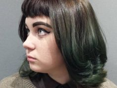 Forest green hair can give your look total fairy vibes.