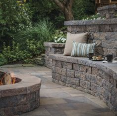 According to the American Society of Landscape Architects, built-in seating has been one of the top 10 trends for the last few years. In addition to providing permanent seating, a seat wall can also help to define an outdoor living space. Fire Pit Seating, Wall Seating, Patio Seating, Garden Seating, Stone Landscaping, Outdoor Landscaping, Outdoor Gardens, Terraced Patio Ideas, Stone Wall Design