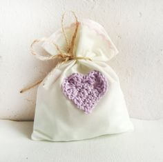 Wedding Favor bags 20, Ivory Cotton Wedding favors and mauve crocheted heart, rustic wedding favor, fabric favors, crocheted favor. $36.00, via Etsy.