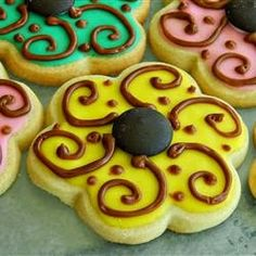 Sugar Cookie Icing | This icing dries hard and shiny and the colors stay bright. Choose as many different food colorings as you desire.