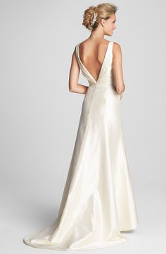 Enamored with the gorgeous plunging v-neck back on this wedding gown.