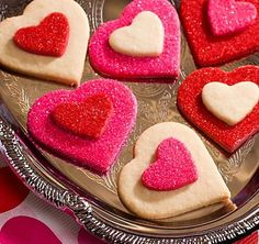 Valentines Sugar Cookies: Make your favorite sugar cookie dough, cut out large and small hearts, and bake. Decorate your cookies with red and pink sprinkles, leaving some cookies plain, then attach the small hearts to large ones in different color combinations.