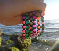 So many colors! #bohemian #medusa #bohobracelet #macrame #handmade #handmadejewelry #gypsyjewelry #gypsylife #statementjewelry #boholife #bohochic #beachjewelry #greece #greekislands #gypsy #nature #glass #beadedjewelry #freespirit #mermaid #handmadewithlove #gift #bracelet #seashell #summeriscoming #summertime #island #greekhandmade #greekdesigners #unisex