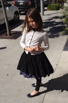 Love the ruffles on this skirt! And leggings to stay warm all fall.