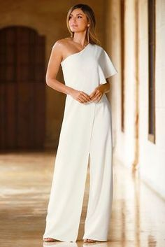 Attaneding a gala or special event? Then make an unforgettable statement int his chic crepe jumpsuit with a sexy one shoulder overlay that drapes one side to reveal split leg
