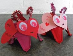 Simple Love bugs, egg carton cut outs for the body and legs, then add colored hears and pipe cleaners.........great idea