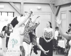 Hilarious shot of bouquet toss. Brides 17 year BFF caught it.