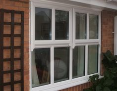 After white upvc window in mock sash style creating a traditional looking design for sash window repairs Upvc Sash Windows, Front Windows, Window Shutters, Casement Windows, Sash Window Repair, Traditional Windows, Window Styles, Window Design, House Front