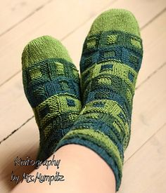 This is a beautiful pattern for either one colored yarn or yarns with longer color changeovers. You can use only one yarn for the whole sock, which will also give a nice structure due to the knit/purl changes or use multiple yarns to create a deeper effect.