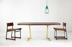 Poly Pop Pendant in Lagoon finish above Token table and chairs