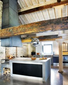 Check it out! A modern + rustic kitchen in Spain