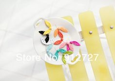US seller:Rabbit ears 9 colors Anti Dust Plug Stopper for iPhone 4 4S 5 or Samsung galaxy & a free pretty gift Pouch. $0,40, via Etsy.