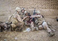 Marines apply a tourniquet and pressure dressing to Woodstock, Ga., native, Lance Cpl. Jeffrey Cole (center) after he was shot twice in the left arm. This photo was taken during a firefight in Marjah Afghanistan after a patrol came under fire from enemy insurgents. Six of the 10 service members on the patrol were wounded, yet Cole continued to provide suppressing fire toward enemy positions to ensure the safety of his fellow Marines.