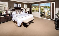The master bedroom includes dual walk-in closets and spa-like bath featuring dual vanities, soaking tub and separate shower. - Residence 3 at Cambridge at Roripaugh Ranch in Temecula, CA
