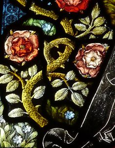 Stained glass window detail  Cartmel Priory in Cumbria, England