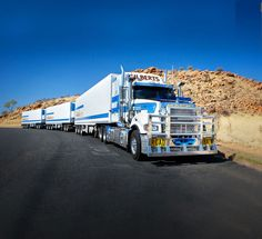 A 'TRIPLE' ROAD TRAIN IN THE OUTBACK.