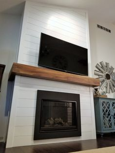 DIY Shiplap Fireplace Project Inspired to reviseHave you always wanted to install a DIY Shiplap fireplace but know how? a step-by-step guide on how we finished our DIY Shiplap fireplace!Shiplap fireplace with fixtures Fireplace Tv Wall, Shiplap Fireplace, Farmhouse Fireplace, Fireplace Remodel, Fireplace Inserts, Fireplace Surrounds, Fireplace Design, Fireplace Mantels, Fireplace Ideas