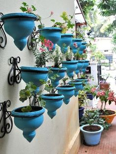 Use multiples.    One bright turquoise planter makes a statement, but 15 of them? Brilliant! Any container used en masse will create a stunning effect. Add a bright color and the effect is heightened even more.