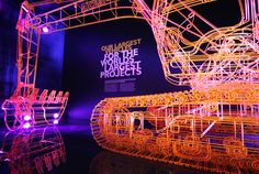 The Story of JCB, by Studio MB. Built to scale from steel rod. Even better than the real thing Exhibition Booth Design, Exhibition Display, Exhibition Space, Exhibit Design, Exhibition Stands, Artistic Installation, Light Installation, Event Lighting, Lighting Design