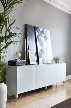 Superfront's ultra-chic cabinet fronts never fail to take things to the next level. Who could ever guess that this elegantly modern credenza came from Ikea?