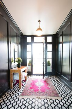 Stonebrook II Project - dramatic entry, entryway decor, entryway ideas, black and white floors, black and white marble, black walls, black high gloss walls, black statement walls, marble floors, burl wood furniture, Thomas O' Brien Hicks Pendant
