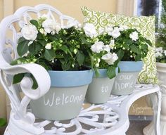 Homemade chalkboard paint painted on flower pots)