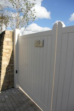 A Contemporary Country Garden by Hendy Curzon Gardens. Auto gates painted in Farrow & Ball Dimity