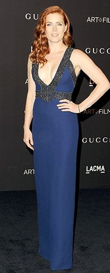 Va va voom! Amy Adams made a statement in a bold Gucci gown with a plunging neckline.
