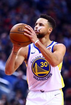 Stephen Curry of the Golden State Warriors shoots a free throw during the second half of an NBA game against the Toronto Raptors at Air Canada Centre...