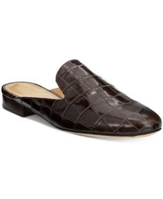 Accent any look with the classic, tailored style of these Natasha slides from Michael Michael Kors in croco-embossed leather for a handsome finish. | Croco-embossed leather upper; rubber sole | Import