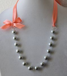 Silver Pearl and Coral Ribbon Bow Necklace by JewelrybyAshNicole, $16.50