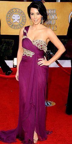 KIM KARDASHIAN is regal in her jewel-encrusted plum Marchesa gown and major Lorraine Schwartz baubles.