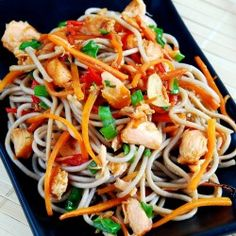 Soba noodles in wok with salmon