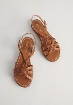 Braid for Walkin' Sandal in Cognac. Walk all over town in effortless, boho-chic style, clad in these tan sandals by Report Footwear. #tan #modcloth