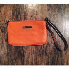 •   Never Used   • Michael Kors wristlet •   Authentic Michael Kors orange leather wristlet with inside pocket   •                                                                           ⚡️REDUCED FROM ORIGINAL ASKING PRICE⚡️ Michael Kors Bags Clutches & Wristlets