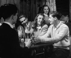 Teenagers socializing. US, 1944;  by Nina Leen This cracks me up! The girl in back is giving the girl in the middle of the guys the stank face!