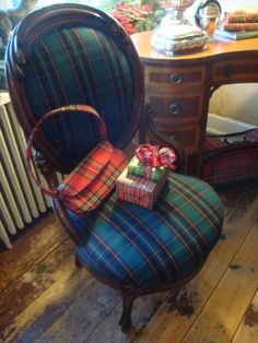 Plaid Chair, Purse, Gifts, Bow (& at right under desk), Small Suitcase