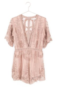 Gorgeous embroidered lace romper with a plunging V neckline. Hidden back zipper for easy on and off closure. Non-stretch lace with stretchy knit lining. - 100% Polyester - Imported