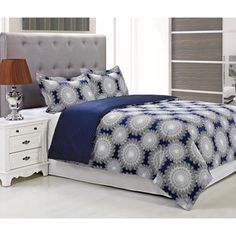 @Overstock - Casey 300 Thread Count Cotton 3-piece Duvet Cover Set - A fun white snowflake spiral design adds contemporary charm to this Casey duvet cover and sham set, crafted with rich blue cotton for comfort and style. Designed with a button closure, this duvet cover is graced with a lovely polka dot reverse.  http://www.overstock.com/Bedding-Bath/Casey-300-Thread-Count-Cotton-3-piece-Duvet-Cover-Set/9240542/product.html?CID=214117 $79.99