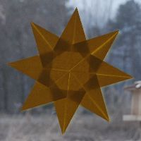 A bright and easy to make origami sun or star. Instructions at www.kids-craft-ideas.com