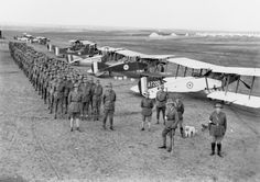 No. 1 Squadron, Australian Flying Corps next to their Bristol F.2 fighters, at Mejdel. The officer in the foreground (with stick) is commanding officer Lieutenant-Colonel R. Williams, 1918.