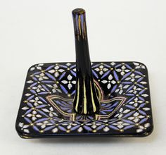 Victorian black glass and polychrome enamel decorated ring stand.