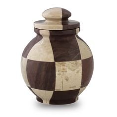 - Brown and white hand made marble keepsake urn with matching lid. - 25 pieces of marble create a mosaic effect. - Keepsake urns made from natural marble will vary in color and pattern. - Bag and adhe