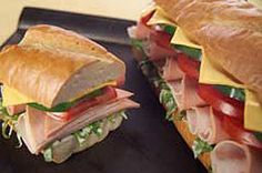Perfect for weekend get-togethers this classic hero sandwich, loaded with bologna, turkey, SINGLES and vegetables is made using a French bread loaf.  Just layer, slice and serve!