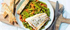 Een heerlijke romige Indiase curry met sperziebonen en een gebakken stukje vis.