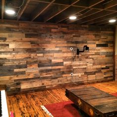 Rustic wood paneling - Daily use of wood paneling can be traced back to England in the late century. The damp English countryside was beautiful, but Popular Rustic Wood Paneling Wall Pallet Accent Wall, Reclaimed Wood Accent Wall, Distressed Wood Wall, Diy Pallet Wall, Rustic Wood Walls, Diy Pallet Projects, Wooden Walls, Accent Walls, Pallet Walls